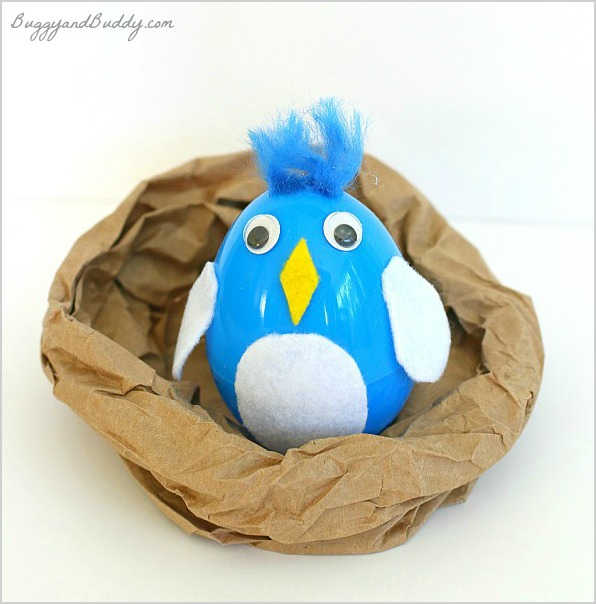 Bird in a nest with plastic egg craft
