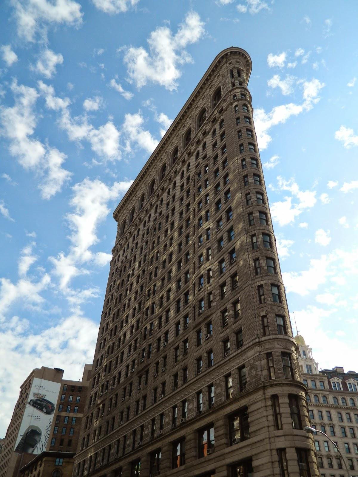 new york city flat iron sun sky reflection side view