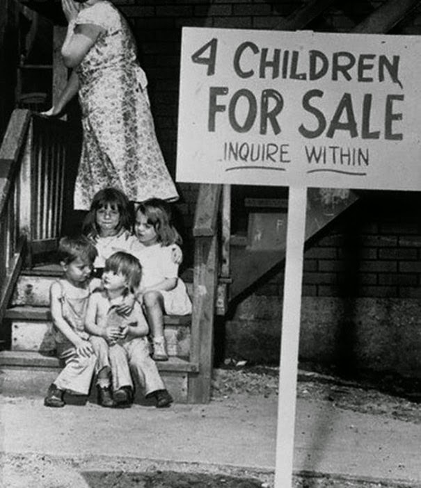 40 Must-See Photos Of The Past - Mother hides her face in shame after putting her children up for sale, Chicago, 1948