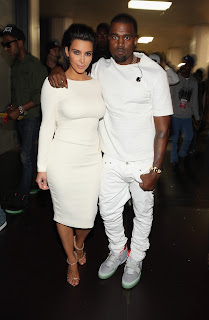 Kim Kardashian and Kanye West in white at  2012 BET Awards