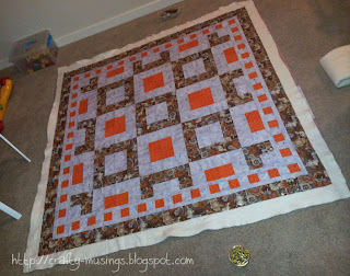 Fall Mystery Quilt basted and ready for quilting