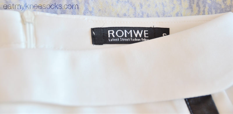 Close-up of the Romwe tag on the leather-trim skort, an original Romwe design.