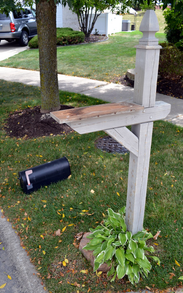 Old and chipped wooden mailbox post needed a serious makeover.