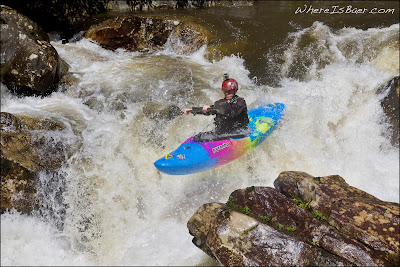 Ty Caldwell launching off of the first ledge at Darwin's Hole, photo by Chris Baer, NC