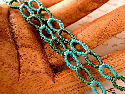 Knotted chain in micro macrame.