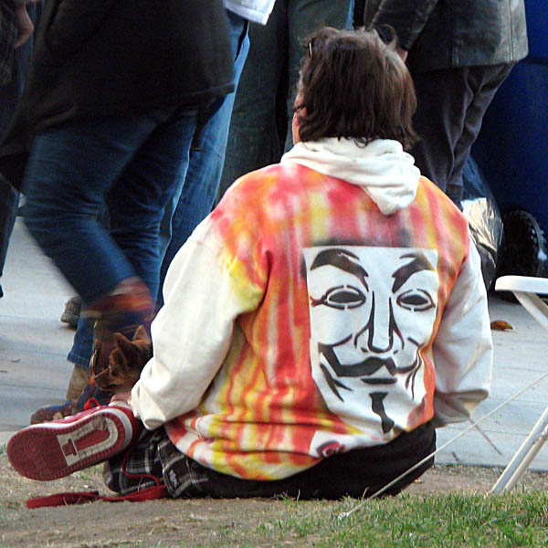 Occupy Los Angeles - someone in an Anonymous/Guy Fawkes sweatshirt
