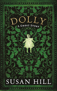 A beautiful old fashioned book cover with green swirls entitled 'dolly' with a lifeless doll beneath the title.