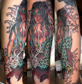 Tattoo of a sexy mermaid in waves by tattoo artist Jason Kunz for Triumph Tattoo