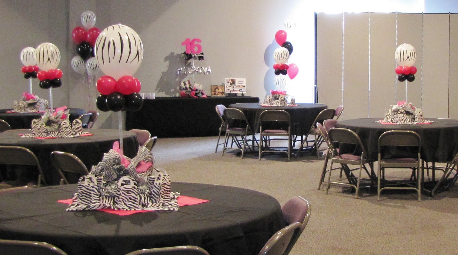 Airfilled centerpieces were placed on the 6 guest tables with Zebra