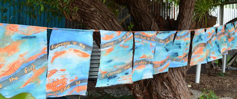 Fish swimming prayer flags