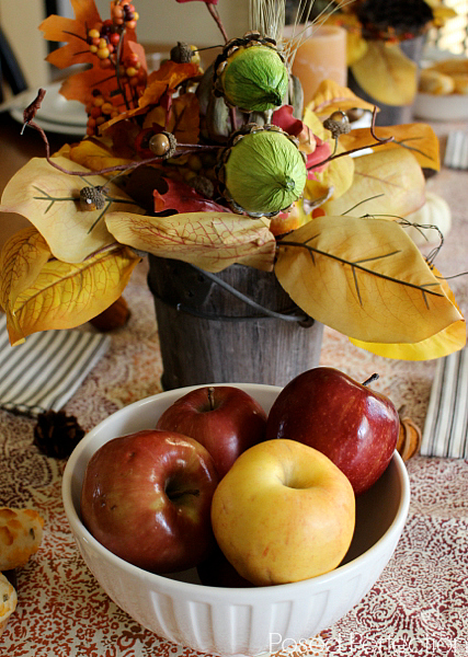 Wooden bucket arrangement with bowl of apples