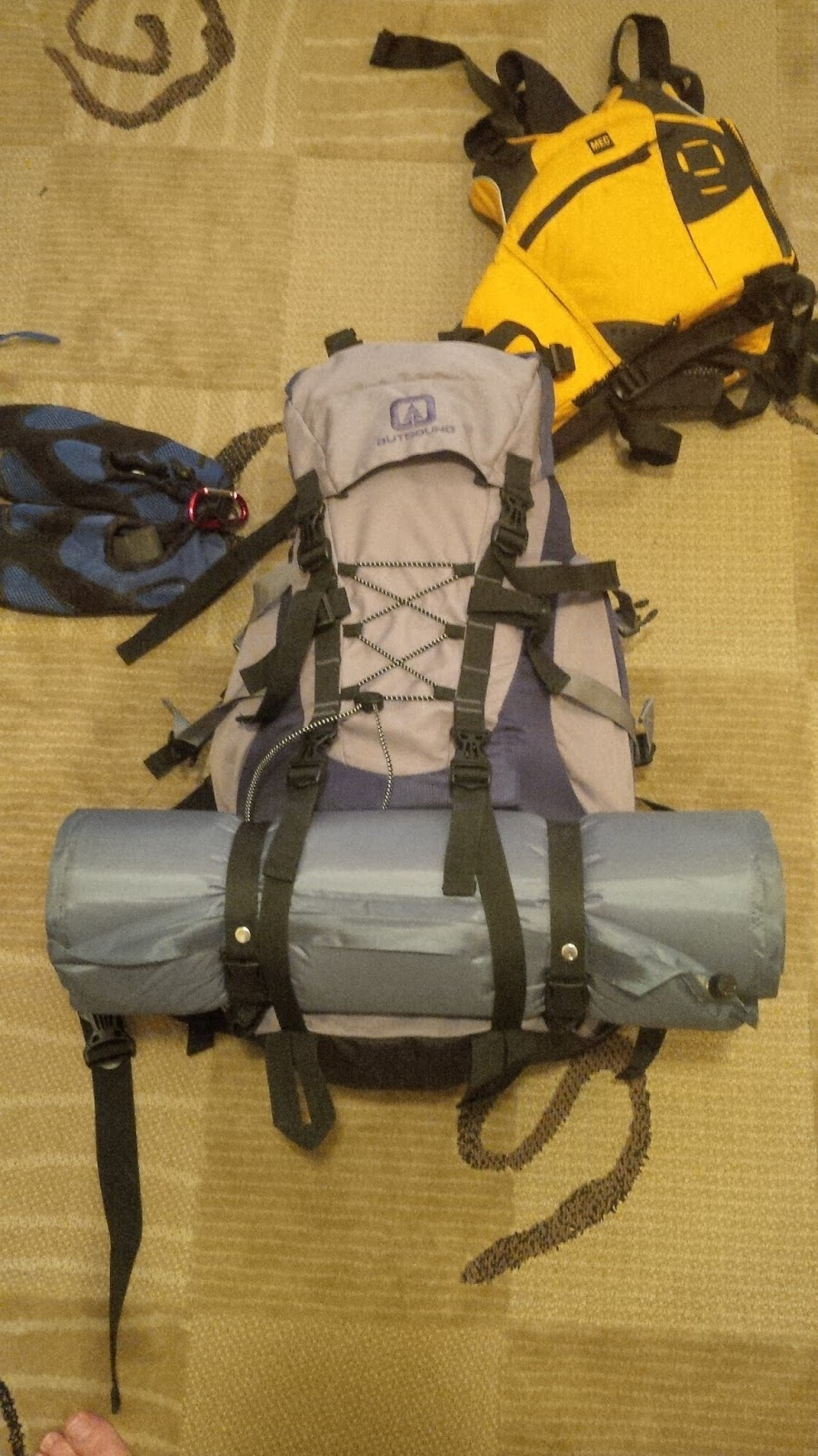 Strapping sleeping roll onto front of pack