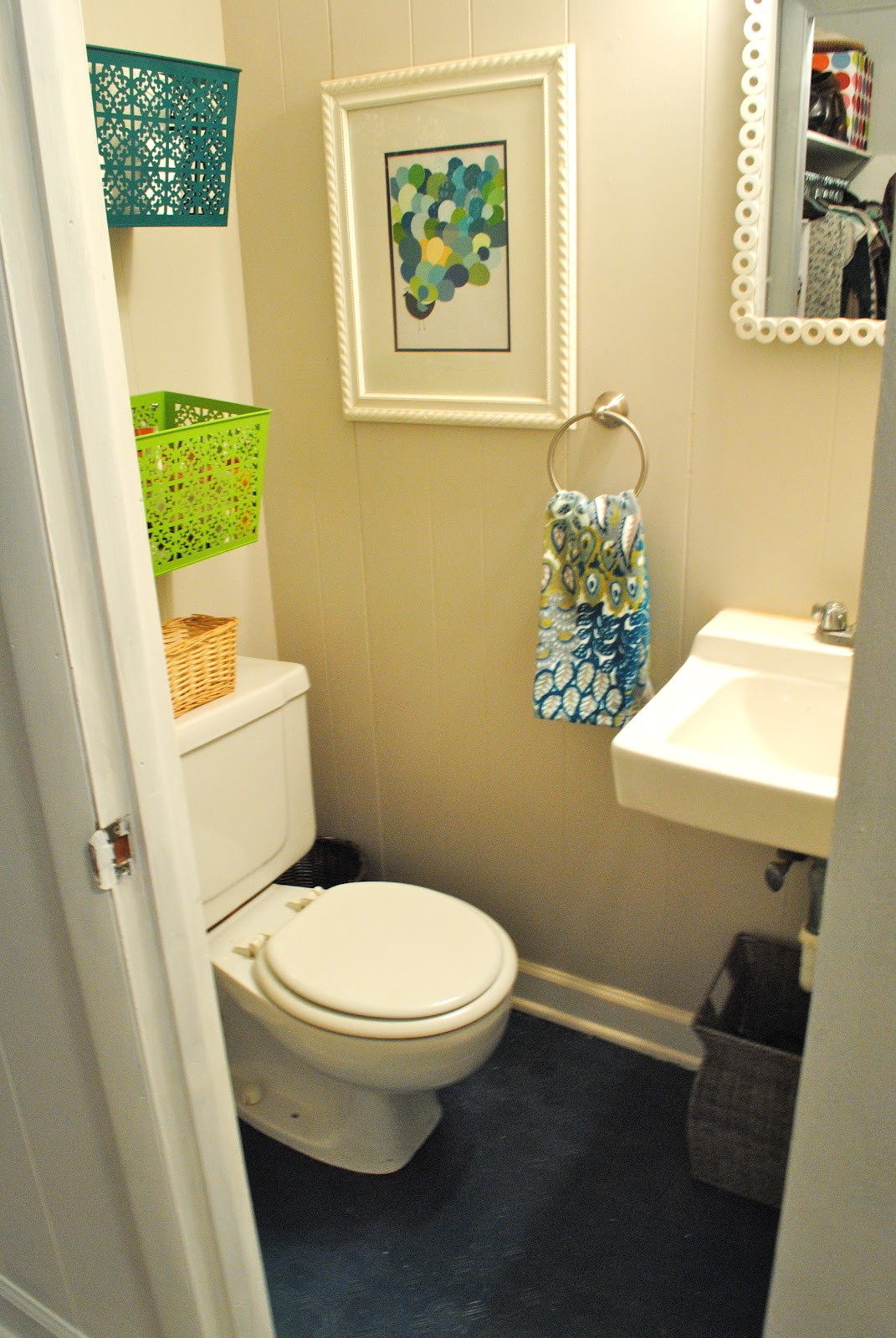 The remodeled life sprucing up the bathroom for Small 1 2 bathroom decorating ideas