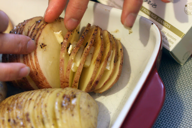 From above: hasselback potatoes sliced and stuffed with brie cheese.