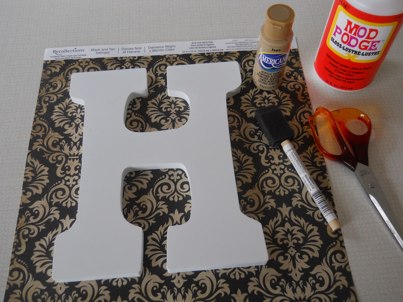 How to put scrapbook paper on wood - Here S A Fun Little Project I Put Together Over The Weekend I Started Off With Some Scrapbook Paper 9 White Wood Letter From Michael S Paint And Mod