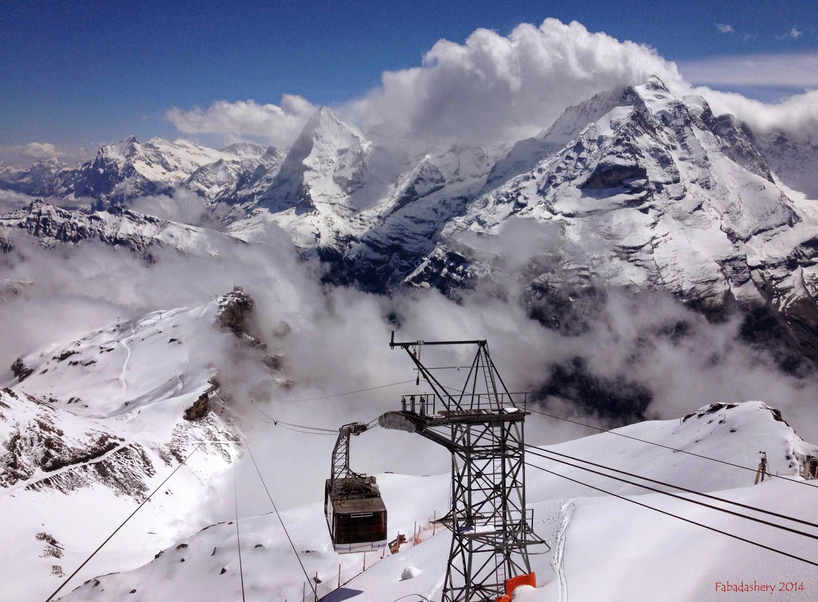 View of the cable car from Piz Gloria, Shilthorn, Switzerlabnd