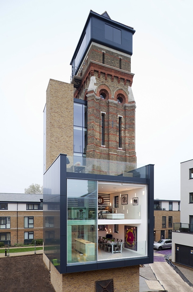 Picture of old brown water tower with modern cube added as new residence