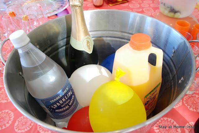 frozen water balloons in an ice bucket