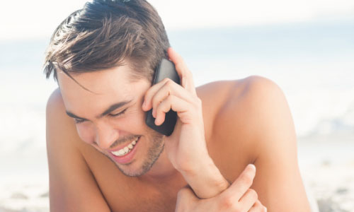 6 Tips on How to Flirt on the Phone,man talks on the phone guy mobile self-phone