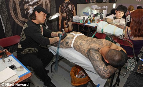Taxpayers to foot the bill for jobseekers 39 tattoo removal for Tattoo removal in kansas