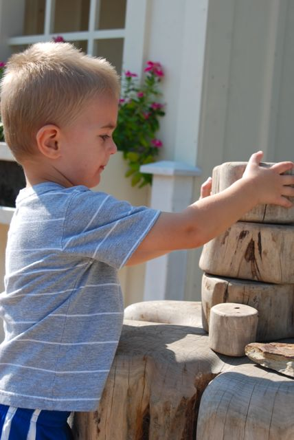 Logan, the builder, hard at work by the playhouse.