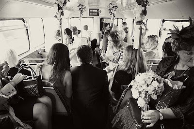 wedding guests on a routemaster bus on their way to the reception
