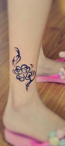 four-leaf clover tattoo on the leg
