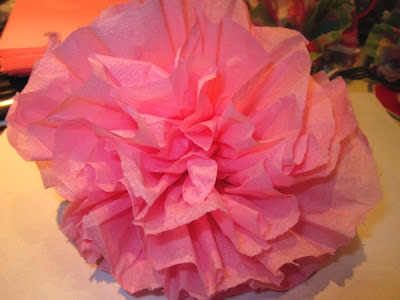 hold the wire -pull the napkin flower up and I squeeze it tight then re-fluff until you like the flowery look