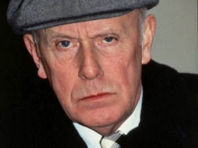 Photo of character known as Victor Meldrew in grey cap and black coat
