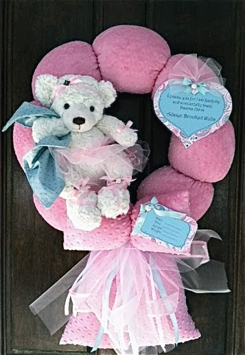 101. PINK AND TEAL BABY WREATH