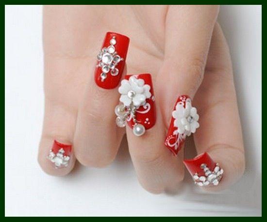 Uñas rojas con perlas
