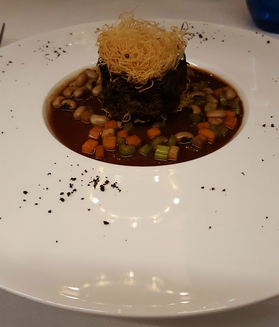 10 Karaköy Istanbul Rudolf Duck leg confit pave with bean stew and angel hair crisp with tamarind and pomegranate essence