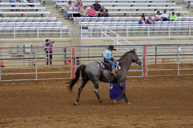 Rider navigating the barrel at the Sheridan Elk's Youth Rodeo