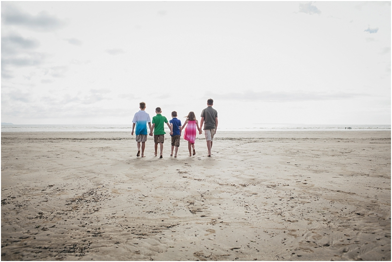 A group of cousins walking across the sand