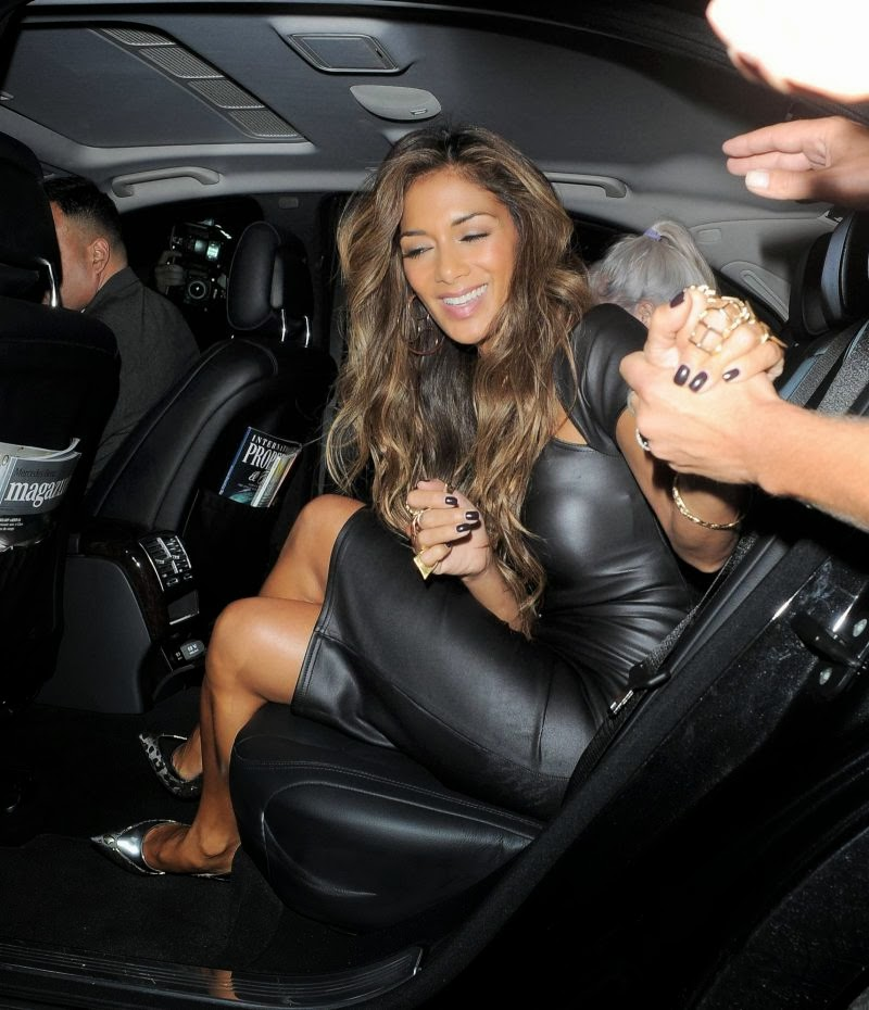 Nicole Scherzinger Photos in Black Dress
