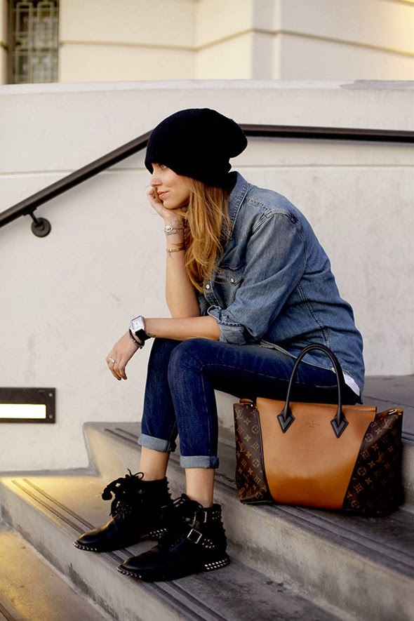 The Combination of Dark Blue Jeans with White T-Shirt, Blue Jeans Shirt, Sports Black Hat, Stylish Boots and Louis Vuitton Modern Handbag