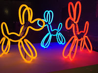 Pic of yellow, blue and red neon lights shaped as dogs