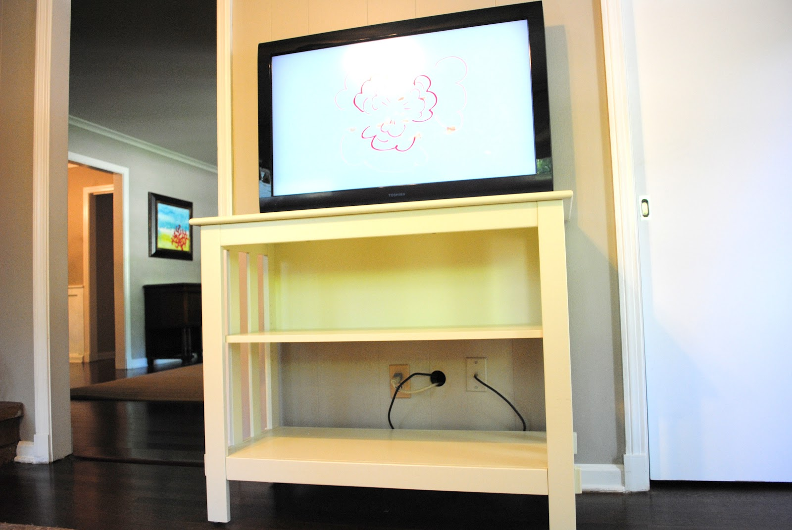midsouth stagers shelving under a wall mounted tv. Black Bedroom Furniture Sets. Home Design Ideas