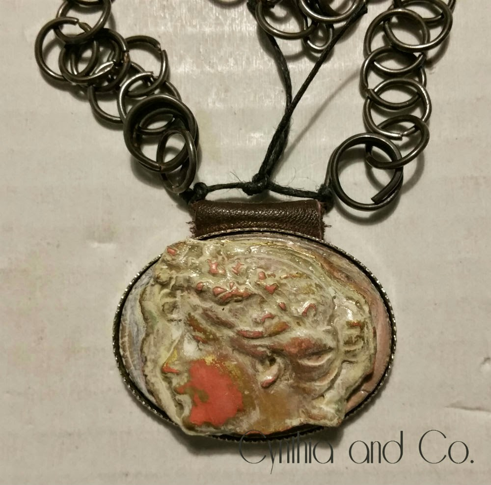 Rustic necklace assemblage with clay cameo and steel chain