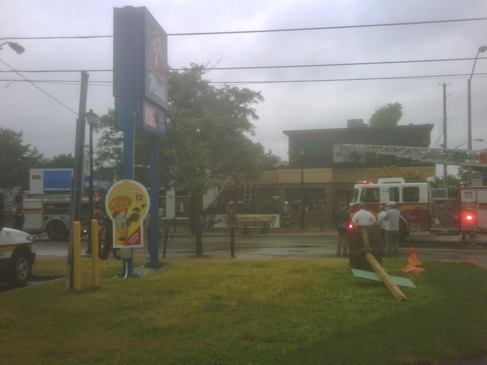 June 24, 2011 - my cell phone snapped this photo through the misty morning air, soon after the fire trucks had arrived on scene.