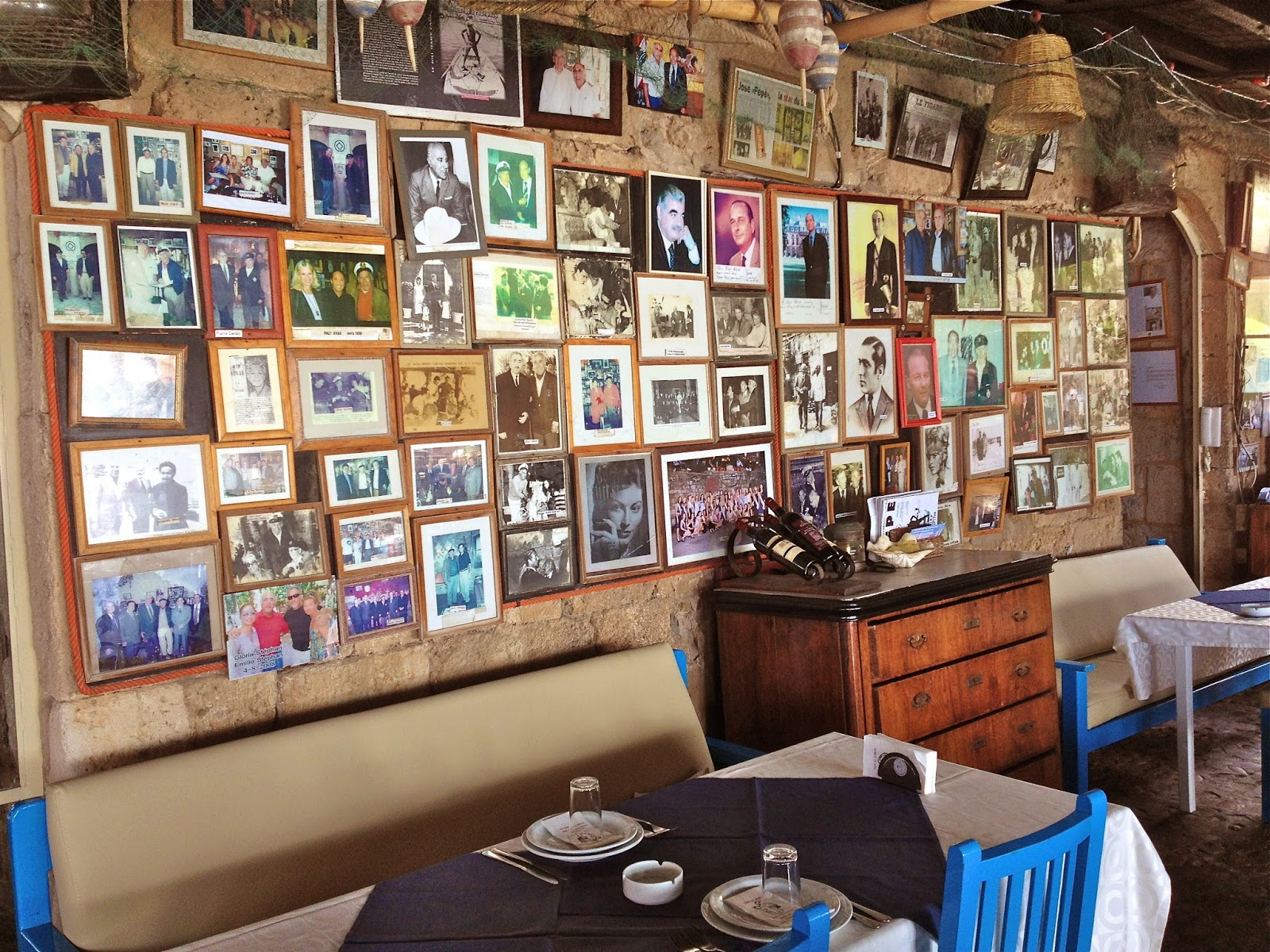 Pictures cover the walls of Pepe's Fishing Club in Byblos.