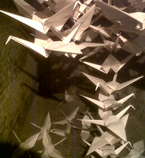 A sculpture based on a mobile of origami birds