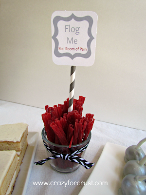 Red licorice sticks in a cup with title