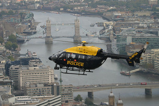 A police helicopter.  Police helicopter helps police gets a big picture of the city, so that the police knows what to focus on.  The police still need to rely on people on the ground for details.  A situation similar to the heuristic described in this article.