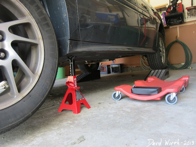 car on jack stands and wheel ramps, creeper dolly