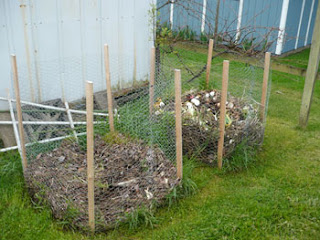 Compost Bins of Chicken Wire and wooden stakes