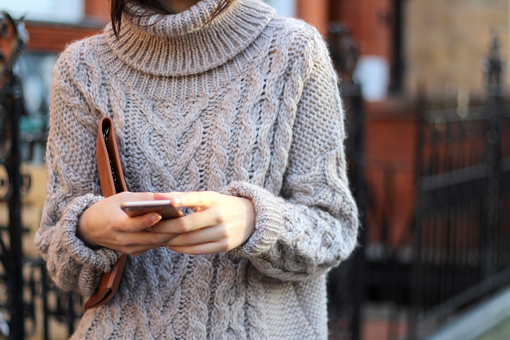 cable knit roll neck jumper worn by peexo fashion blogger