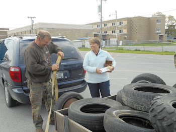 Senator Ritchie Collects Old Tires