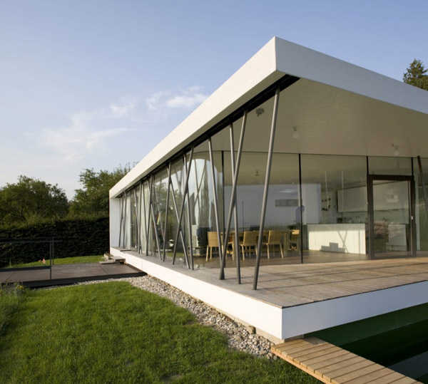Compact glass wall house austria most beautiful houses for One story modern house