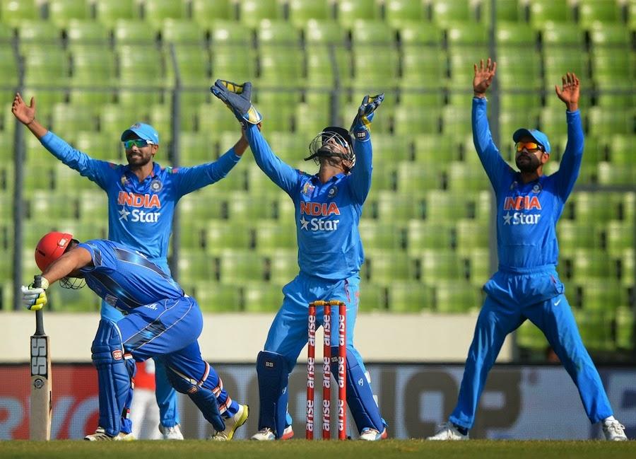 Ravindra-Jadeja-Dinesh-Karthik-Virat-Kohli-India-vs-Afghanistan-Asia-Cup-2014